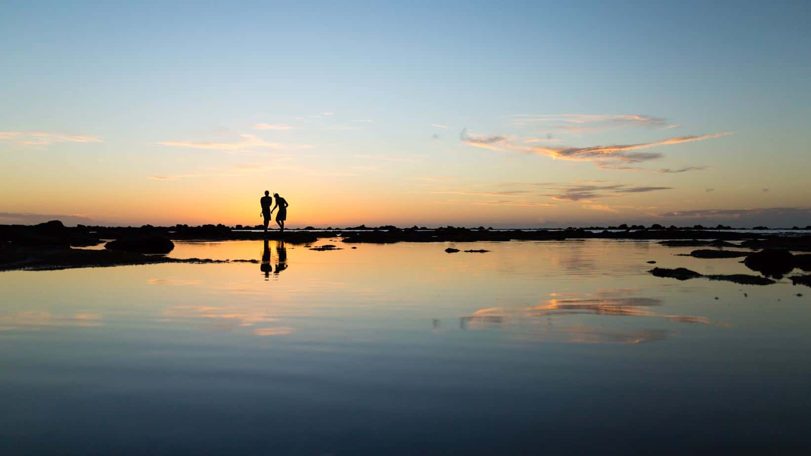 Couple on Shore Sunset