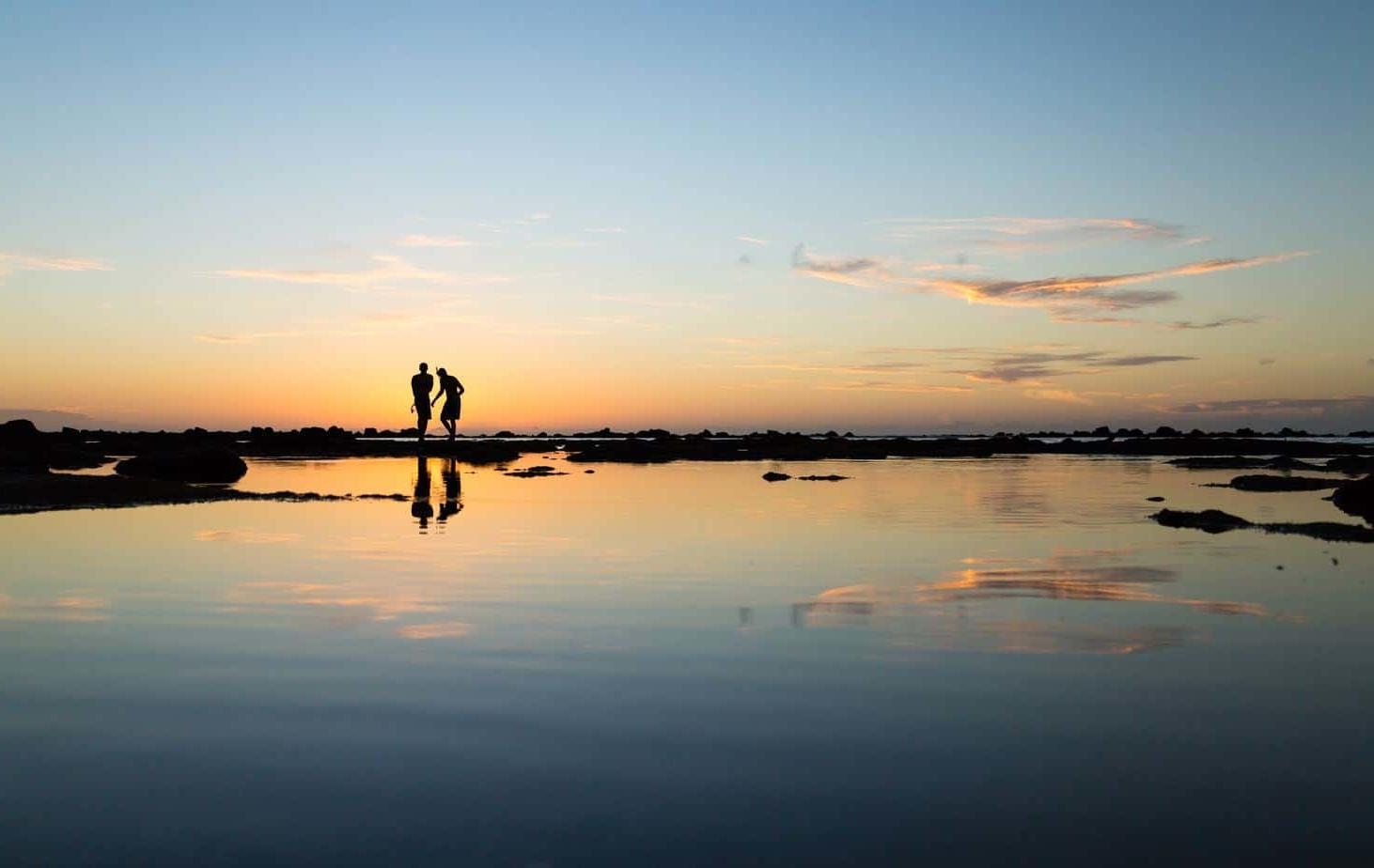 Couple on Shore Sunset